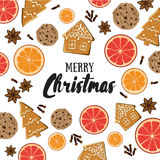 Merry Christmas! Holiday greeting card with ginger bisquit, orange and grapefruit slices, spices and calligraphy elements. Stock Photos