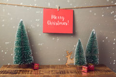 Merry Christmas holiday greeting card handing on wall with pine tree Stock Photo