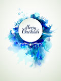 Merry Christmas inscription on the abstract winter background. Merry Christmas hand drawn inscription on the blue abstract winter background with holiday symbols Stock Photo