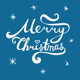 Merry Christmas inscription. Hand drawn lettering with curves. C. Alligraphy script on blue background for your greeting card Royalty Free Stock Image