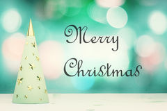 Merry Christmas inscription with menthol christmas tree with gol Royalty Free Stock Images