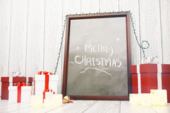 Merry Christmas inscription on picture frame with red and white Stock Image
