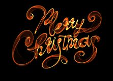 Merry Christmas isolated text lettering written with flame fire light on black background. Orange red color.  Royalty Free Stock Photography