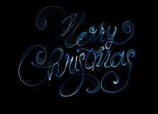 Merry Christmas isolated text written with flame fire light on black background. Blue color.  Royalty Free Stock Photo