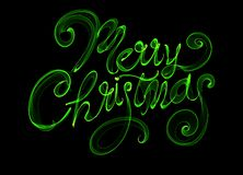 Merry Christmas isolated text written with flame fire light on black background. Green color.  Royalty Free Stock Photography