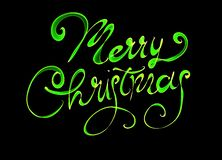 Merry Christmas isolated text written with flame fire light on black background. Green color.  Royalty Free Stock Images