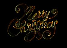 Merry Christmas isolated text written with flame fire light on black background. rainbow colors.  Stock Photos
