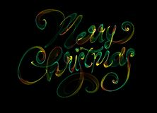 Merry Christmas isolated text written with flame fire light on black background. rainbow colors.  Royalty Free Stock Photography