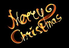 Merry Christmas isolated text written with flame fire light on black background. Violet and Yellow color.  Royalty Free Stock Images