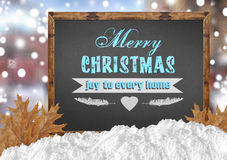 Merry Christmas joy to every home on blackboard with city leaves Stock Image