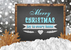 Merry Christmas joy to every home on blackboard with forest leav Stock Photos