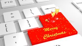 Merry Christmas keyboard with baubles and champagne Stock Photos