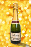 Merry Christmas on a label of a bottle of Champagne Royalty Free Stock Image