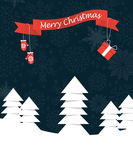 Merry Christmas landscape with ribbon and mittes hanging on it. Merry Christmas forest landscape with red ribbon and rnit mittes hanging on it Royalty Free Stock Images