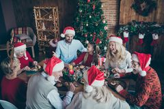 Merry christmas large family reunion gathering meeting sit table have x-mas feast father in santa claus hat cap joke