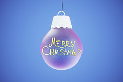 Merry Christmas lettering on blue christmas tree ball at blue ba Stock Photography
