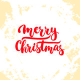 Merry Christmas - lettering Christmas and New Year holiday calligraphy phrase  on the background. Fun brush ink Royalty Free Stock Photography