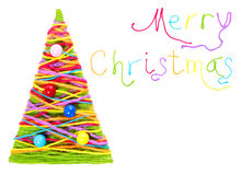 Merry Christmas. Lettering from colorful thread over white Royalty Free Stock Photo