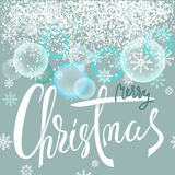 Merry Christmas lettering design with blue and white snowflakes. Transparant New Year Balls. EPS10 Royalty Free Stock Photography