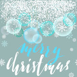 Merry Christmas lettering design with white snowflakes. Transparant New Year Balls. Christmas lettering. EPS10 Royalty Free Stock Photography