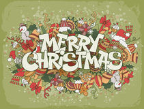 Merry Christmas. Lettering on festive doodle background with elements of winter holidays Royalty Free Stock Photography