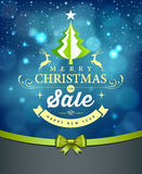 Merry Christmas lettering green tree sale design blue background Stock Images