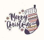 Merry Christmas lettering handwritten with elegant calligraphic script and decorated with knitted stocking or sock and royalty free illustration