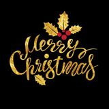 Merry Christmas lettering. With a Christmas gold decor for the holiday printing and web design, glittering stars and gold glitter Royalty Free Stock Image