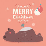 Merry Christmas lettering postcard with cute brown bear laying  Royalty Free Stock Images