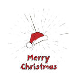 Merry Christmas lettering and Santa Claus Hat with vintage sun star burst frame Royalty Free Stock Photo