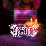 Merry christmas lettering with sparkles on blurred background with candles Stock Images
