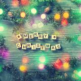 Merry christmas letters. On a wooden background stock photo