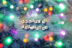 Merry christmas letters. On a wooden background royalty free stock photography