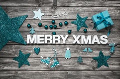 Merry christmas letters in white with turquoise decoration for a Stock Images