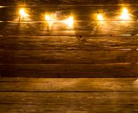 Merry Christmas! Christmas light background on brown rustic wooden background.  stock photography