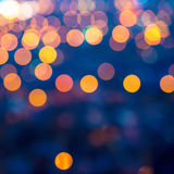 Merry christmas lights abstract circular bokeh on blue background, closeup royalty free stock image