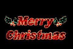 Merry Christmas in lights. Pretty Merry Christmas in lights on black background royalty free stock image