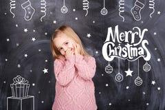 Merry christmas from little girl Stock Photo