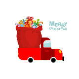 Merry Christmas. Machine carries bag of gifts. Car and Red sack Royalty Free Stock Photography
