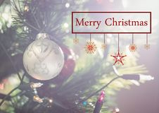 Merry christmas message against christmas decoration Royalty Free Stock Photo