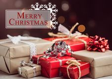 Merry christmas message against christmas gift boxes Stock Photos
