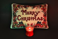 Merry Christmas Message with Red Candle Black Bkgrnd Royalty Free Stock Image