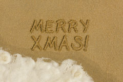 Merry Christmas message in the sand. Merry Chrismaas message written in the sand on the beach Royalty Free Stock Photography