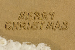 Merry Christmas message in the sand Stock Photo