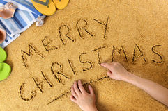 Merry Christmas message on sunny Caribbean beach, Christmas holiday vacation concept Royalty Free Stock Photos