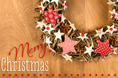 Merry Christmas Message Wreath Decoration White and Red Stars Gi. Merry Christmas message, handmade wreath decoration Shabby Chic white wooden stars with red Royalty Free Stock Photos