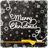 Merry christmas message, written on the black. School chalkboard with curl lettering. Like a greeting for school christmas holidays Stock Images