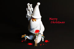 Merry christmas miniatures. Miniature figures painting santa Claus Royalty Free Stock Photo