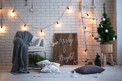 Merry christmas and new year brick wall background. white decor. Loft style.  royalty free stock image