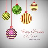 Merry Christmas and New Year card with balls. stock image